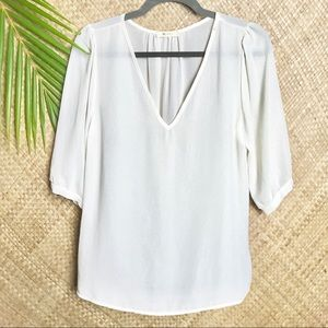 Everly v neck blouse off white shimmer fabric.